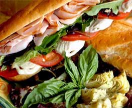Image of Isabella's delicious mouthwatering Italian Sub on fresh in-store baked bread with authentic Italian meats, homemade mozzarella cheese with fresh greens, tomatoes and artichoke hearts Little Italy Baltimore MD