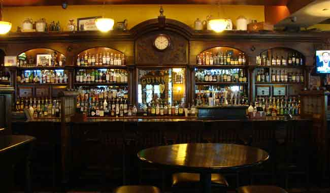 Photo of James Joyce authentic handsome Irish dark wood bar imported from Ireland, an inviting setting to have a drink, 616 S. President Street, Harbor East, Baltimore MD