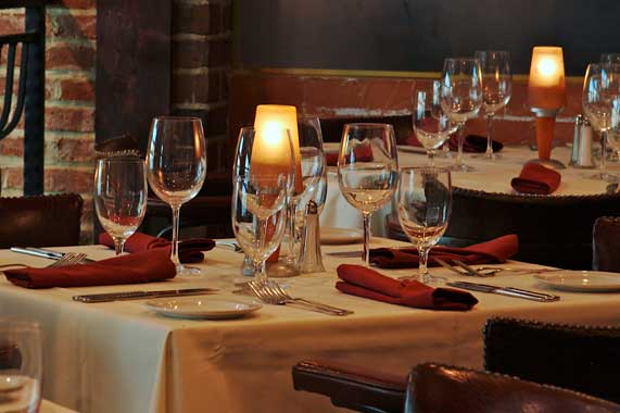 La Scala's Elegant Dining Room with Candlelight and Glistening Wine Glasses