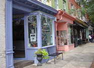 Image of unique & colorful storefronts along historic Charles Street in Federal Hill, a Baltimore neighborhood named one of the 5 Great American Main Streets, located just south of the Inner Harbor, MD