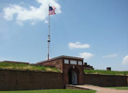 Image of entrance to Fort McHenry with replica of 1812 U. S. flag & information placard in foreground Locust Point, Baltimore, MD