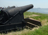 Image of huge black Fort McHenry cannons aimed out towards the Patapsco River as they were in the War of 1812 Locust Point, Baltimore, MD