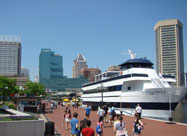 Image of Harborplace & the Inner Harbor Promenade with day-cruise ship & people enjoying the harbor, Baltimore, MD