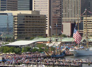 Image of huge crowds of people on the Inner Harbor waterfront enjoying tall ships & the Blue Angels performance & proudly celebrating the 200th anniversary of the writing of our National Anthem at the Star-Spangled Spectacular on September 14, 2014 in Baltimore, MD