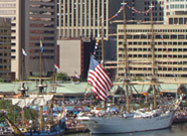 Image of U.S. Coast Guard ship with huge U.S. flag flying proudly in celebration of the 200th anniversary of the writing of our National Anthem, Inner Harbor Baltimore, MD